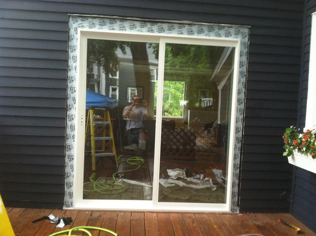 Exteriors replace sliding door screen saugus henry for Sliding screen door installation